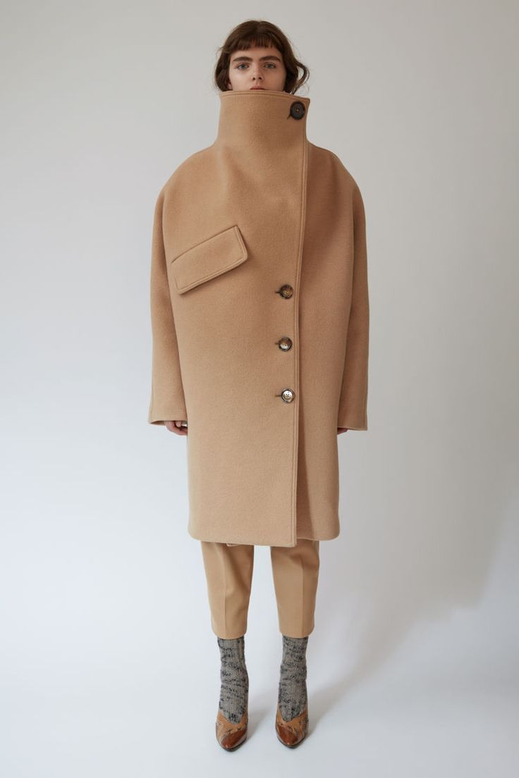 Acne Studios Ciara Boiled camel is a double breasted cocoon coat with an exagerrated 80s funnel neck collar.  #PAW17