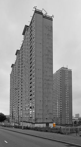 The Red Road Flats in Balornock, Glasgow, Scotland. There was 8 towers built as post-war housing when construction started in 1964 and was completed in 1969. At the time they were the tallest residential buildings in Europe. The tallest of the eight towers was 31 floors and the eight towers housed 5,000 people. The Red Road flats are on tract to be demolished and site cleared by 2017.