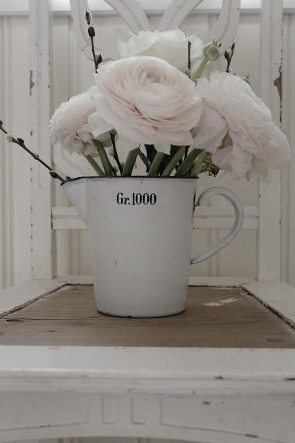 Flowers in rustic vases