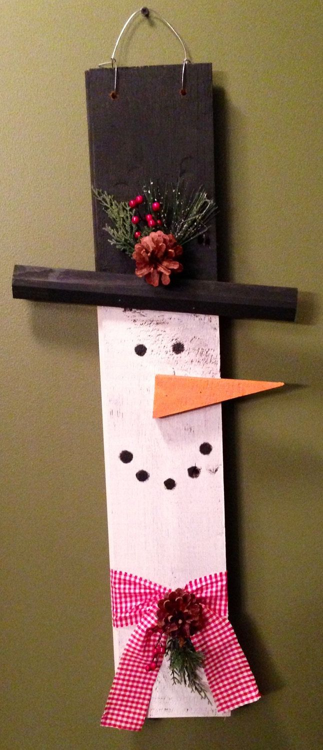 Snowman made from old barn wood