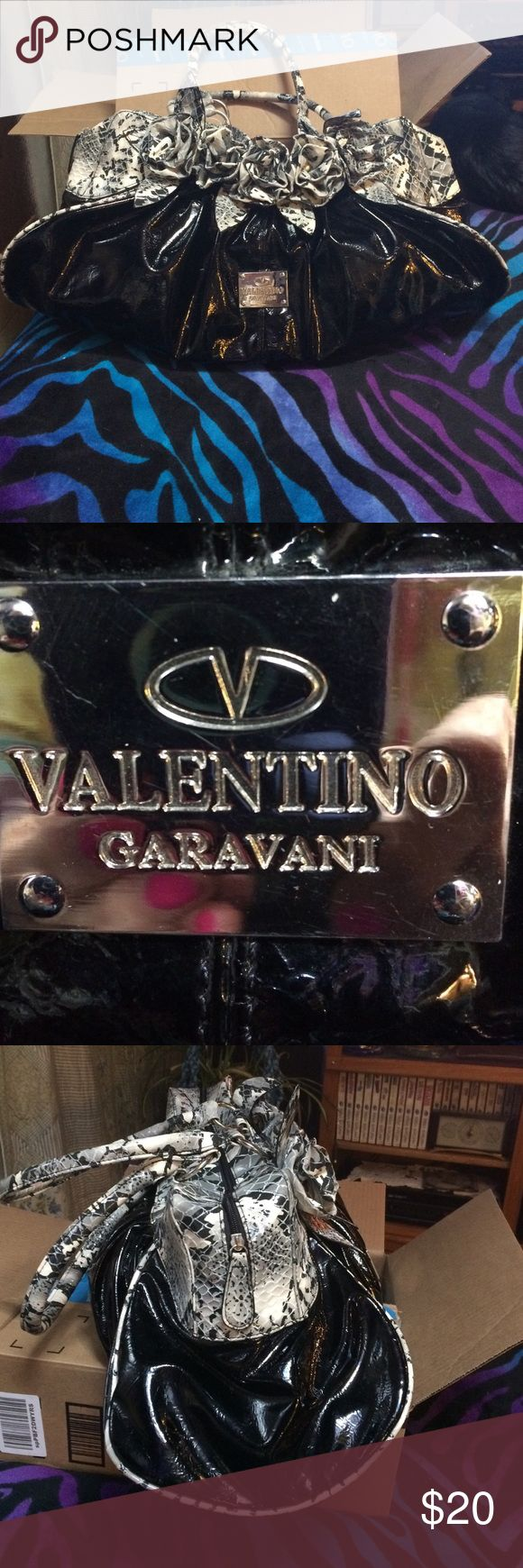 Valentino Garavani🌺made in China🌺huge purse Huge❤excellent condition ❤I know nothing of the brand, tag inside says made in china🎀it was a gift🎁not really my style. It's so big it could be like an overnight bag Valentino Garavani Bags