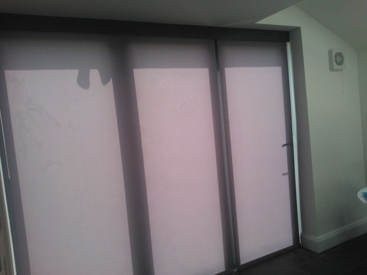 Reduce heat glare and uv with blinds for bifold doors by for Door roller blinds