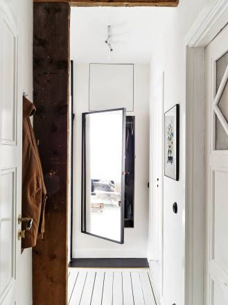 Behind-the-mirror clever built-in storage solution with industrial details by ApartmentStudios