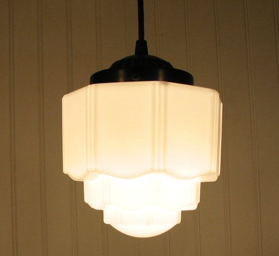 this vintage light fixture is beautiful