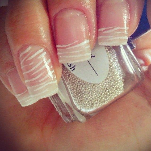 Simple white zebra print nail art.