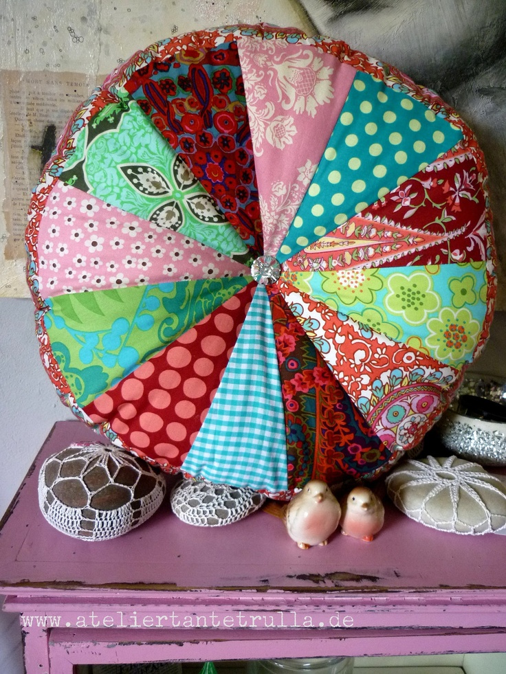 patchwork cushion round with sparkling glassbutton. €39.00, via Etsy.