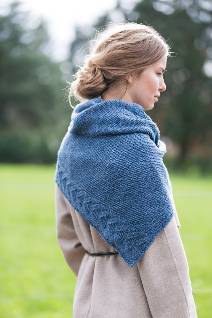 """""""I wanted to design a minimalist blanket shawl without superfluous details — useful all the year long, a sort of cozy envelope. The wrap you like to have always nearby, perfect for rainy afternoons on the couch or cool evenings outside. I added a subtle feminine touch by working a lace motif along two edges."""" …"""