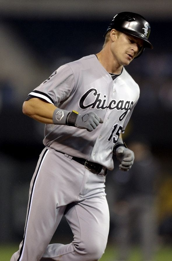 KANSAS CITY, MO - SEPTEMBER 18: Gordon Beckham #15 of the Chicago White Sox rounds third after hitting a home run against the Kansas City Royals in the sixth inning at Kauffman Stadium on September 18, 2012 in Kansas City, Missouri. (Photo by Ed Zurga/Getty Images)