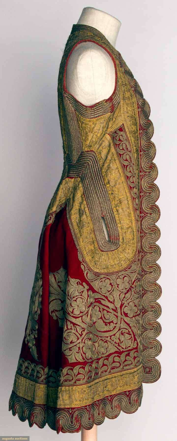 WOMAN'S SLEEVELESS COAT, ALBANIA, 19TH C Red wool w/ elaborate gold metallic embroidery & gilt trim, printed cotton lining