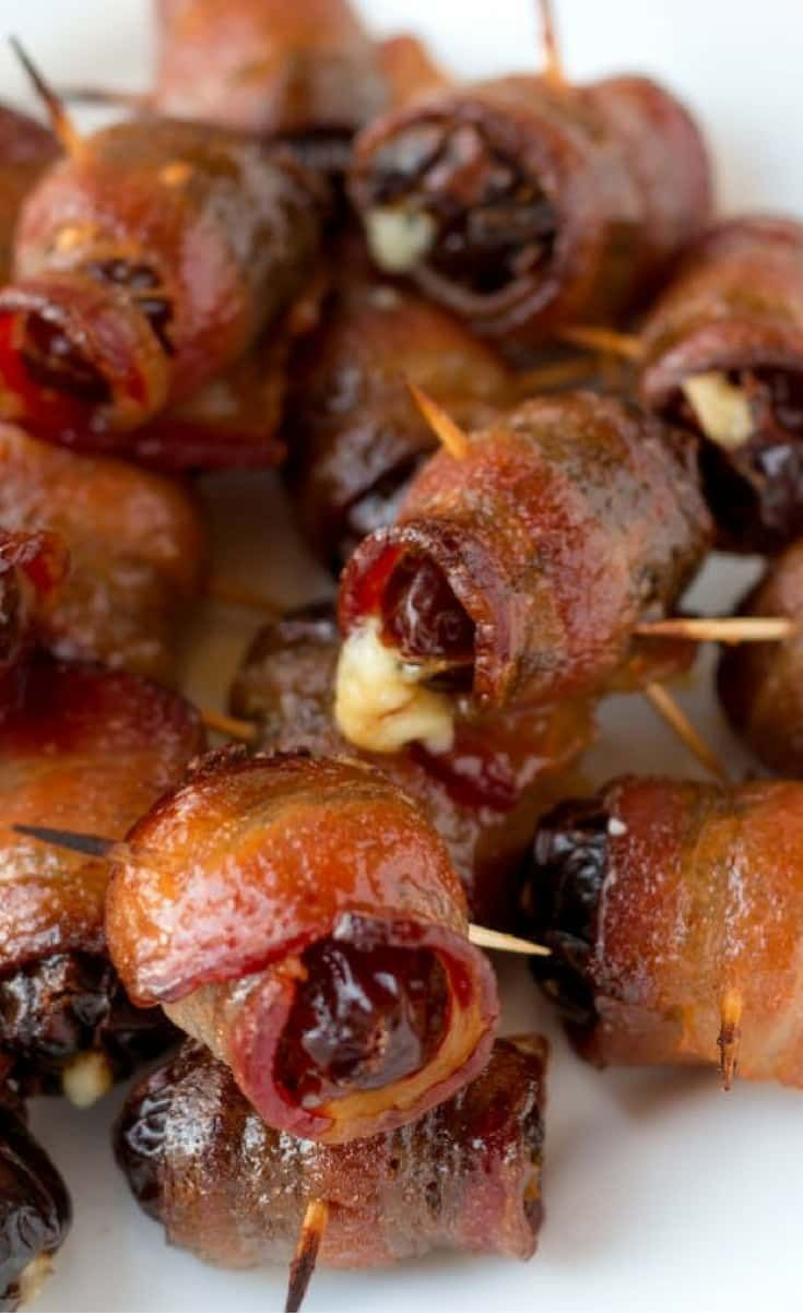 Medjool dates are stuffed with blue cheese, wrapped in bacon, and crisped with a Maple-Sriracha glaze. Maple Sriracha Devils on Horseback are a perfect party snack!