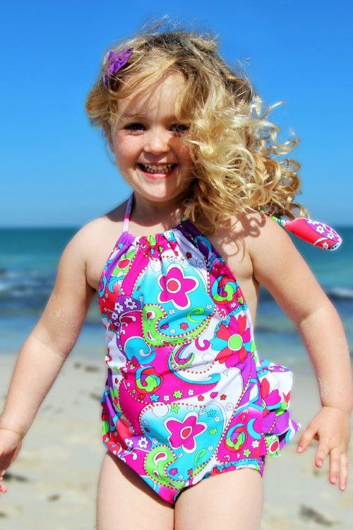 """$49.95 2 Year Swimsuit Sizes 1, 2, 4, 6 •Our signature """"HeavenLee"""" swimsuit •A bright paisley print •3 full ruffles on back •Adjustable halter neck •Generous fit, with 2 seasons' growth •Nylon lycra with UPF 50+ www.heavenleecreations.com.au"""