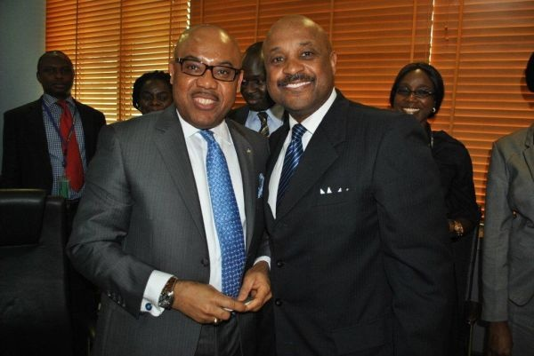 Willie Jolley and Executive Director Public Sector FirstBank's U.K Eke