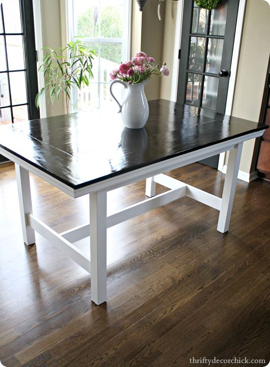 IKEA table to farmhouse table ....I actually love the green with white and black color scheme of the room