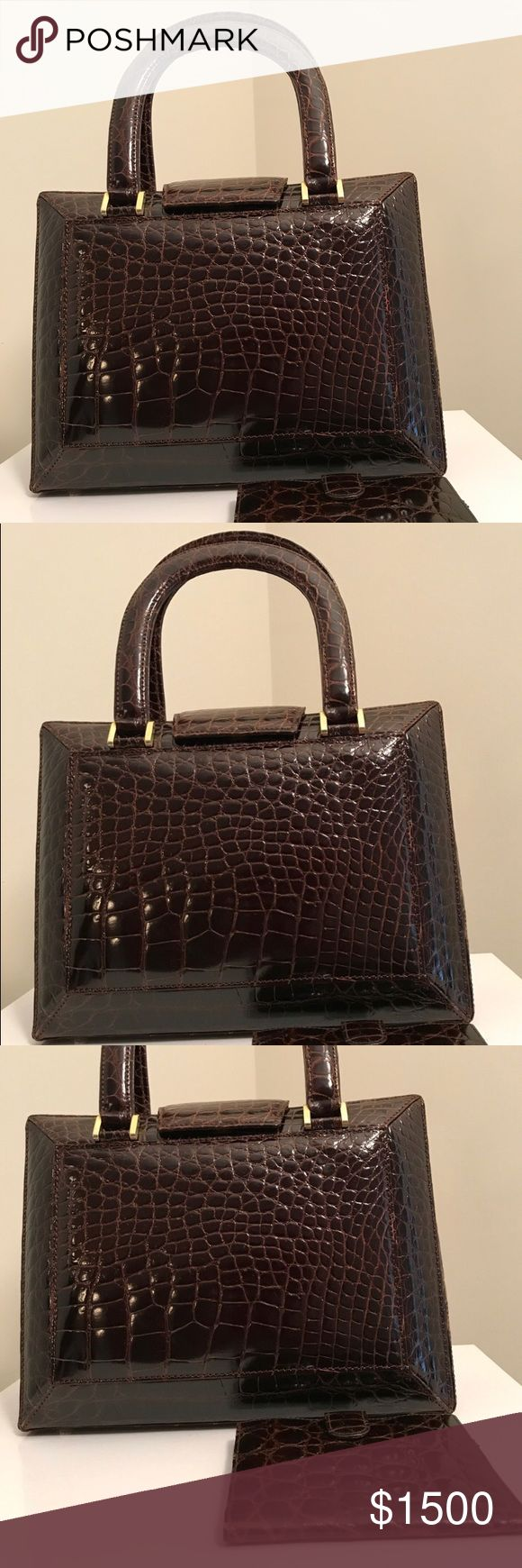 "✨HOST PICK.✨Crocodile • Handcrafted in Italy 🇮🇹 ""Luxury Item"" #AUTHENTIC #CROCODILE This is a ONE OF A KIND. This beauty has a brown leather lined interior. Shown. Crocodile wallet is a #GWP. #Handcrafted by expert craftsman to designers AND purchased at an exclusive boutique in #Italy. Top Handle 6"" drop. DIMENSIONS 10 W X 8 H X 4 D. Magnetic snap-flap closure. Gold Tone hardware accents. Two inside zip pockets one in center. One inside phone slot. NWOT Comes with dustbag. Pictures are in…"