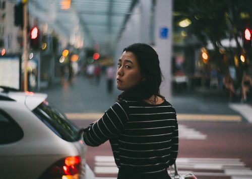 She turns and stares at the man with the hard to miss Petzval lens.