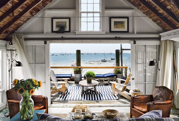Wharf home in a converted bait and tackle storage building looks out out onto Cape Cod Bay in Provincetown. [1800  1216]