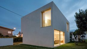 """Faced with the difficult task of delivering a house for €100,000, Portuguese architect José Carlos Nunes de Oliveira designed this concrete """"mini-bunker"""""""