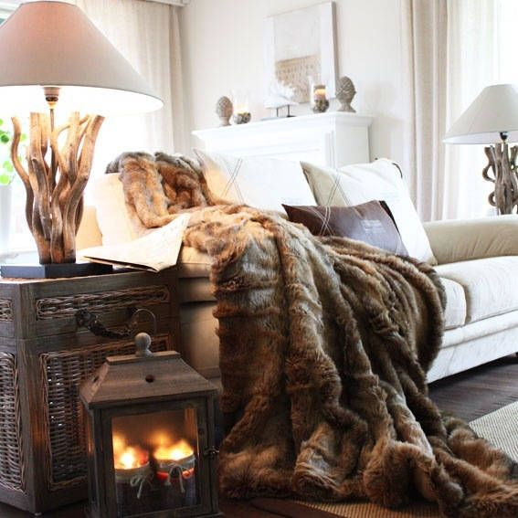Living room theme: cozy. Nothing cozier than a FAUX fur blanket. I also love the wood lamps they have here.