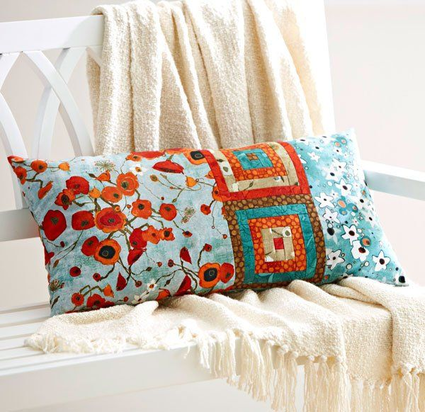 Two Log Cabin blocks and rectangles in a fun print come together to make a  delightful throw pillow.