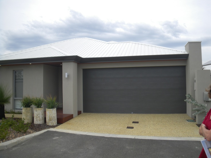 Like this look, wide gutters and colours, but maybe miniorb sectional door