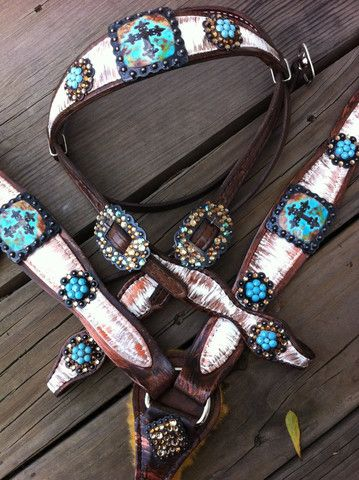 Distressed white with Turquoise Conchos! Love and would look awesome on my horse.