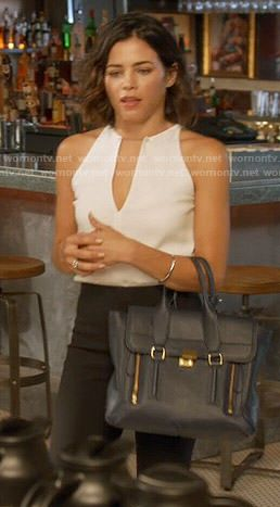Lucy's white keyhole top and navy bag on Supergirl.  Outfit Details: http://wornontv.net/54314/ #Supergirl