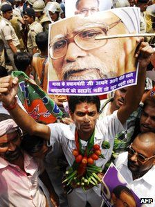 A supporter of India's opposition National Democratic Alliance holds a poster of Indian Prime Minister Manmohan Singh, who has been criticised for inaction.