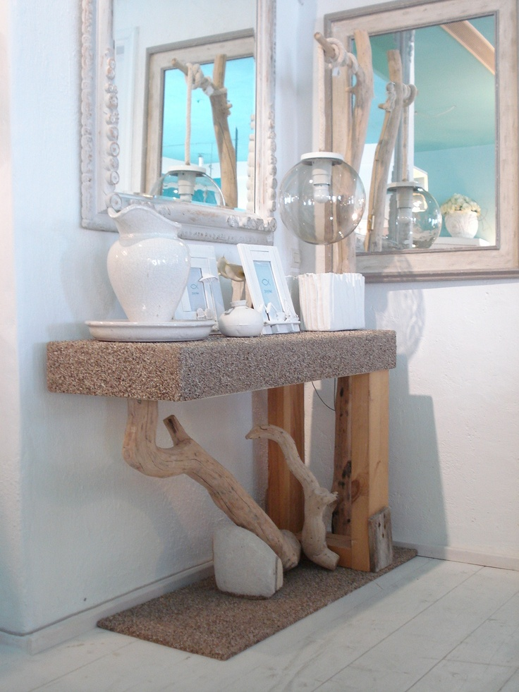 Handmade console with natural industry, light and stony base and top. Display at Chora Art Home Design.