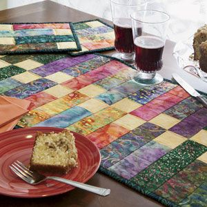 Zippy Strippy: Scrappy Batik Strip-Pieced Table Ensemble Quilt Pattern  Designed and Machine Quilted by ABIGAIL DOLINGER; this quilt is patterned in McCall's Quilting magazine, July/August 2013, available for purchase in print or instant digital download edition at http://www.quiltandsewshop.com/category/mccalls-quilting/?m=categorysub_mccalls-quilting