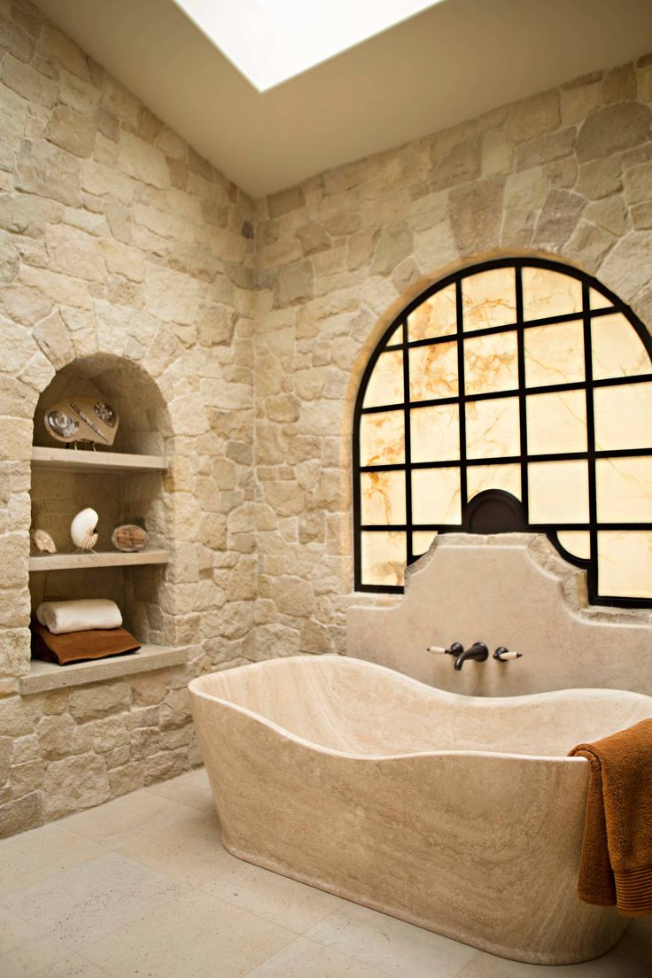 Love the built in shelves and the walls... Elegant Mediterranean bathroom in beige with limestone tiles.