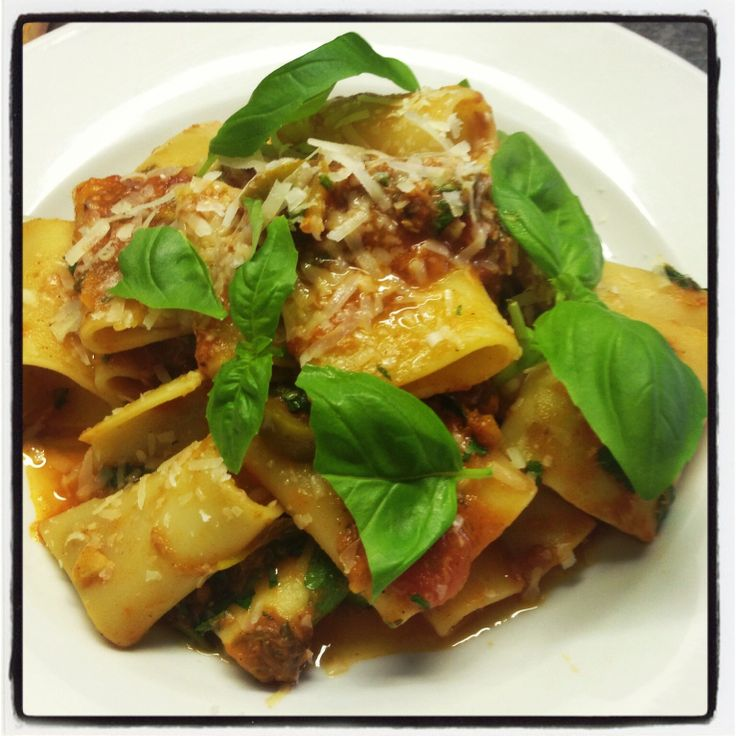 Paccheri di tonno Pacceri pasta with a sauce of tomato, tuna, anchovies, olives and caper.