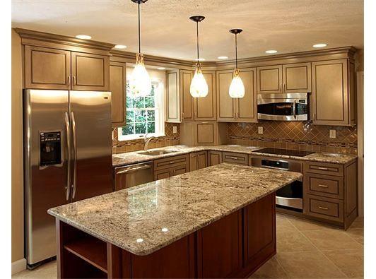 Lavish kitchen design with marble countertops and pendant for Lavish kitchen designs