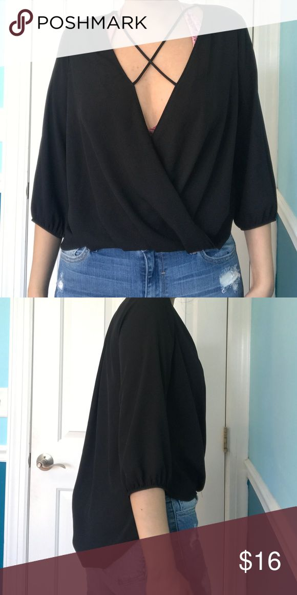 Black chiffon wrap going out top Super cute quarter sleeve going out top. Black chiffon and a criss cross pattern makes this perfect to go out. High low shirt so it's longer in the back. The front dips pretty low so it's perfect to wear with a bralette. Size XS but can fit size small miami Tops