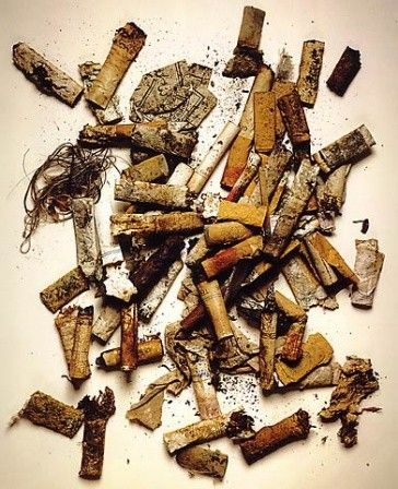 Still life - Irving Penn. This shows a visually unattractive image of cigarettes, reinforced by the quite dark colours of the image, as there is a lot of brown and dark orange. This was part of a series called 'Street Findings' where he found objects in the street, such as these cigarettes, and captured images of them. It is a direct contrast to his other types of photography as it is deliberately unappealing.