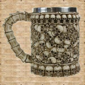 A haunting pile of skulls covers this tankard and the handle has the appearance of spine bones. This skull tankard has a removable stainless steel insert for ease of cleaning measuring approximately 12.5cms deep with a diameter of 8cms. The Skull Pit Tankard brought to the Skulls and Dragons drinkware range by Nemesis Now.    Height : 14 cm    Width : 11 cm    Length : 17 cm    Weight : 750.00g    Made from resin, stainless steel    Ref : SDAL50068   Was £18.99 Now Only £9.50