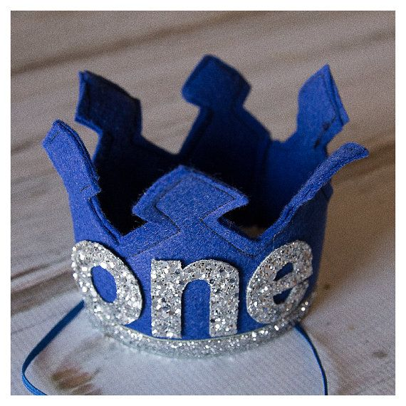 First Birthday Felt Crown Shown in first pic with Royal Blue Felt and Metallic Silver glitter fabric letters that spell out ONE  Ready to ship in 1 business day as shown  Measures approximately 3 3/4 High by 4 in diameter   Crown can be customized in many different colors. custom options available under birthday crowns and hats