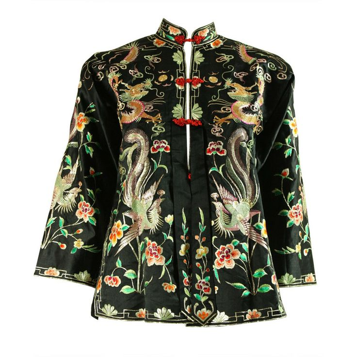 Vintage embroidered jacket originates from China and dates to the 1930's through 1940's. It is made of black satin with allover embroidery. It has center front frog closures, 3/4-length sleeves, and a back vent. Fully lined.