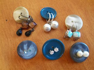 Use buttons for keeping earring pairs together. Great for keeping your jewelry box organized. Also great for packing for a trip.