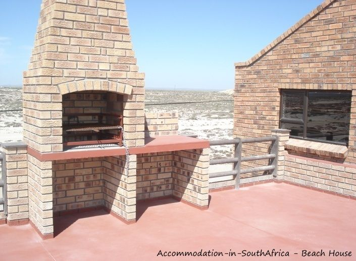 Beautiful outdoor braai at Beach Houshttp://www.accommodation-in-southafrica.co.za/NorthernCape/PortNolloth/BeachHouseAccommodation.aspxe Accommodation.
