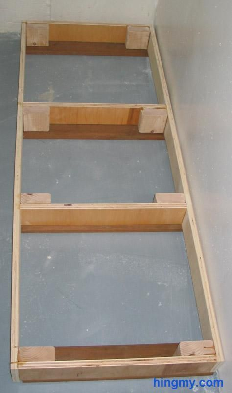 "Building Base Cabinets...toe kick should be 4"" tall...build a frame out of 2X4 then use a plumb line to trim down the back and sides to account for patio slope?"