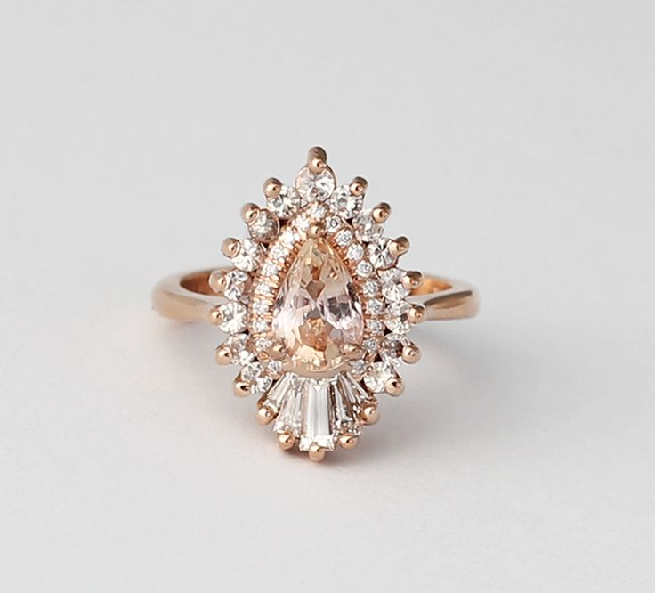 The Rhapsody with peach sapphire by Heidi Gibson. Absolutely LOVE her rings.