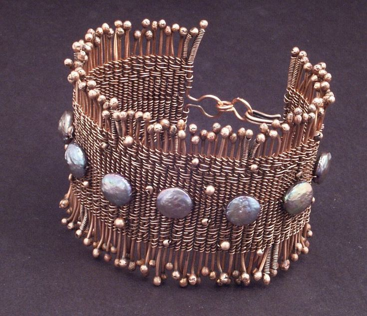 "Mary Tucker -   Twined Copper Wire Coin Pearl Cuff | 2.5"" wide cuff of twined copper wire and coin pearls"