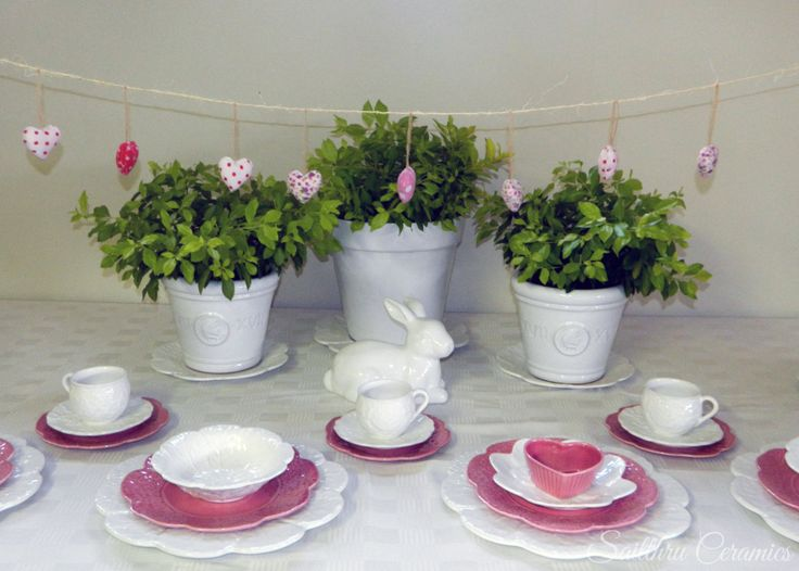 Pink and white cabbage wear with white plant pots and rose teacups