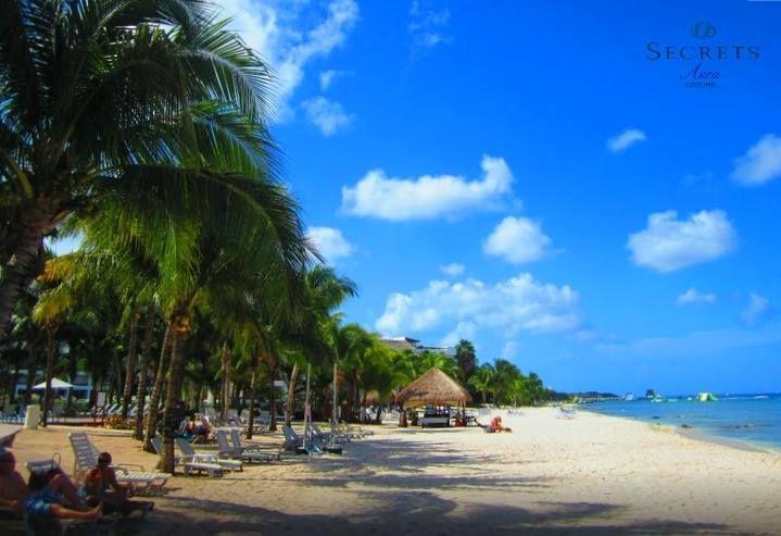 Blue skies and sandy white beaches await you at Secrets Aura Cozumel!