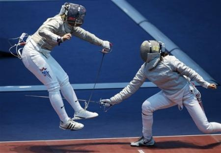 The United States' Dagmara Wozniak, left, competes with Tunisia's Azza Besbes in the women's individual sabre fencing competition at the 2012 Summer Olympics, Wednesday, Aug. 1, 2012, in London.(AP Photo/Andrew Medichini)