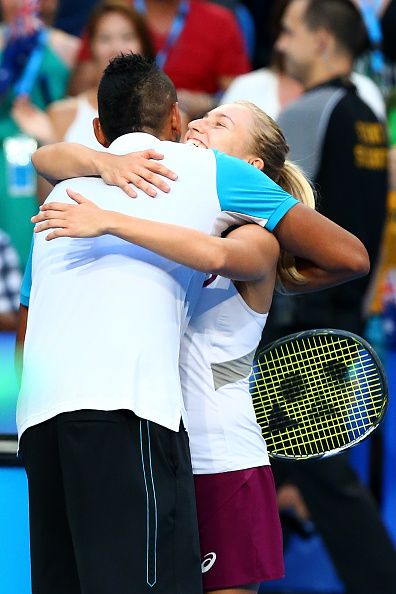 Nick Kyrgios of Australia Green is hugged by Daria Gavrilova after defeating Alexandr Dolgopolov of the Ukraine in the men's singles final during day...