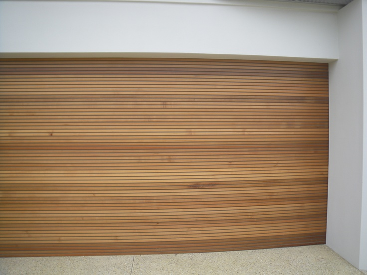 Solid Cedar garage door- expensive ($7000) but super stylish and very solid