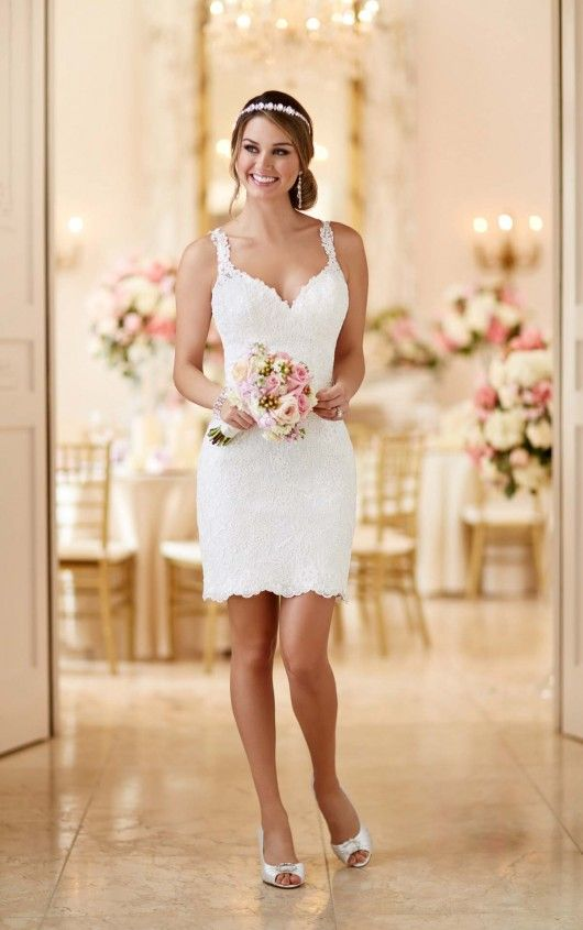 Two Stella York dresses in one! For the ceremony, wear this luxurious above-knee lace dress with its floor-length tulle and Royal organza princess skirt. After the ceremony, celebrate with your friends and family sans tulle skirt, and dance the night away with ease. The back of the lace dress features beaded illusion lace that zips up with ease under coordinating pearl buttons.