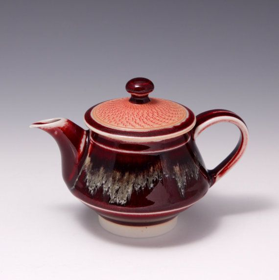3 3/4 x 5 1/4 x 3 1/2, 6 ounces, Wheel-thrown Porcelain Teapot with Golden and Copper Red Glazes by Hsinchuen Lin    All of the glazes I use on the