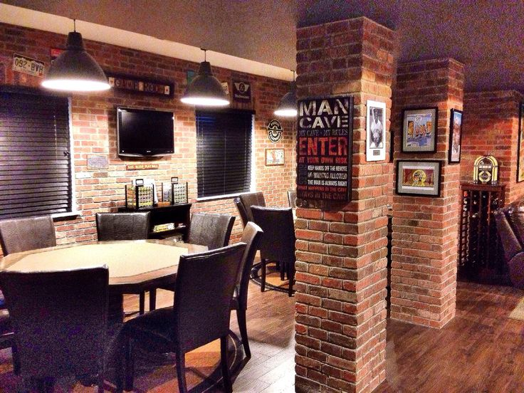 The DIY thin-cut brick gives a pub feel to our poker room in the man cave. It only took us three days to do the brick on one long wall and four short walls and the two columns.